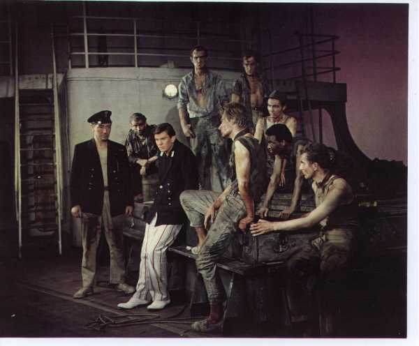 a rare production photograph! Alan is front row, second from right, with foot on bench